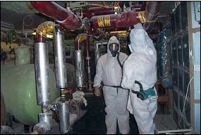 Checking for Asbestos (photo courtesy of GTC-AMAS)